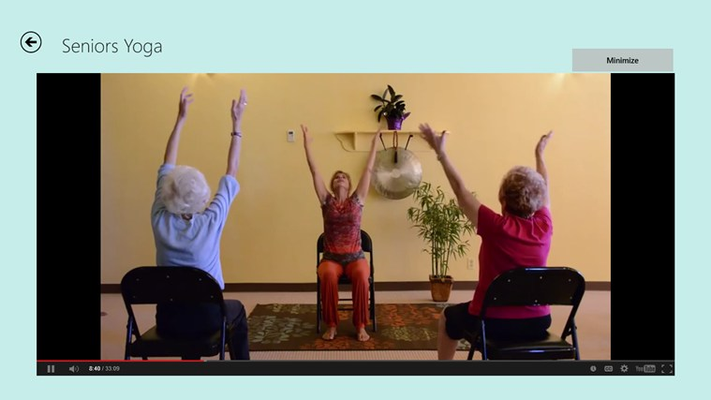 Full screen view of a senior yoga video.